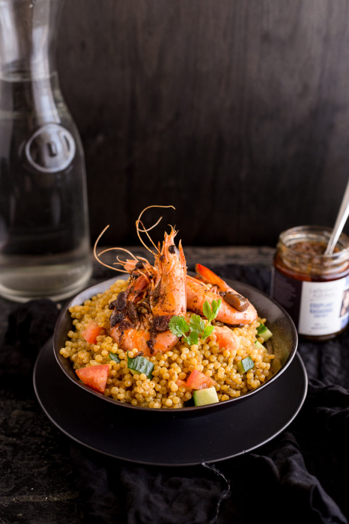 Prawns with Eggplant Kasundi Paste on a bed of cous cous